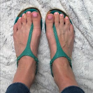 Teal sandals with gold trim and satin bottoms